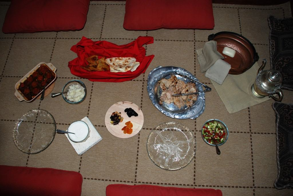 Dastarkan a rug on the floor with cushions and the Afghan meal