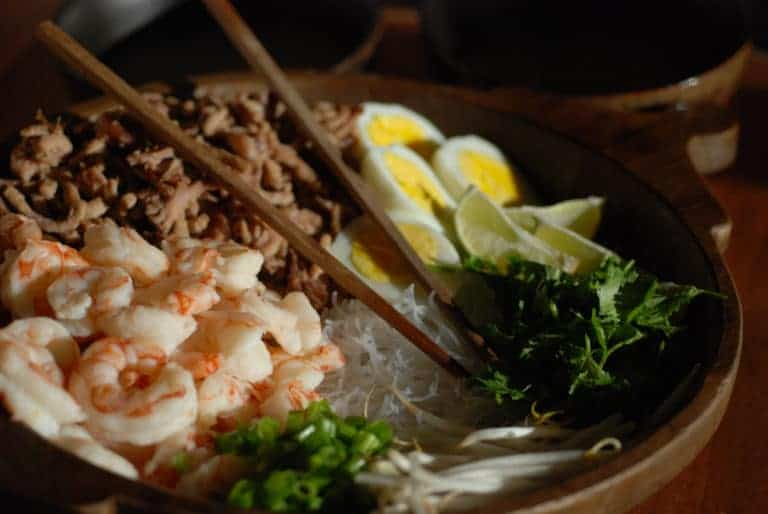 A picture of Kuy Teav, a soup made with shrimp, pork and glass noodles