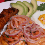 A plate full of Ecuadors llapingachos with avocado, chorizo and a friend egg.