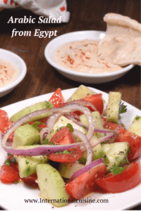 An Egyptian salad made with tomatoes cucumber and onions served with tahini and pita bread.