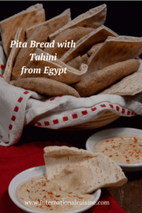 A basket of Egyptian pita bread served with tahini.