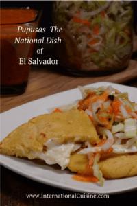 A plate full of pupusa , curtido and salsa roja from El Salvador