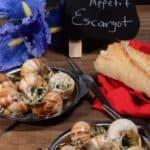 A dozen french escargot in a garlic butter sauce