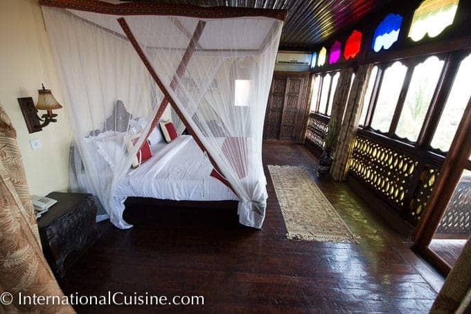 Picture of a beautiful netted four poster bed in the Presedential Suite at the Dhow Palace Hotel in Zanzibar.
