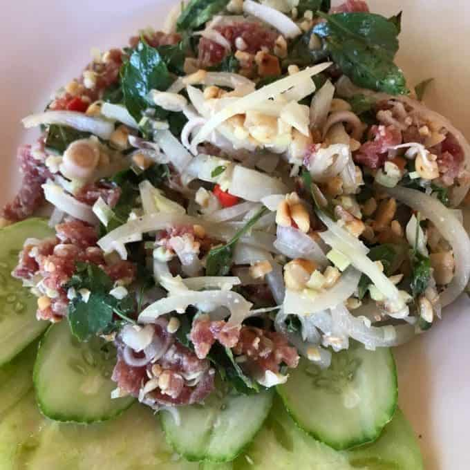 Fresh beef Salad on a plate served with cucumber slices