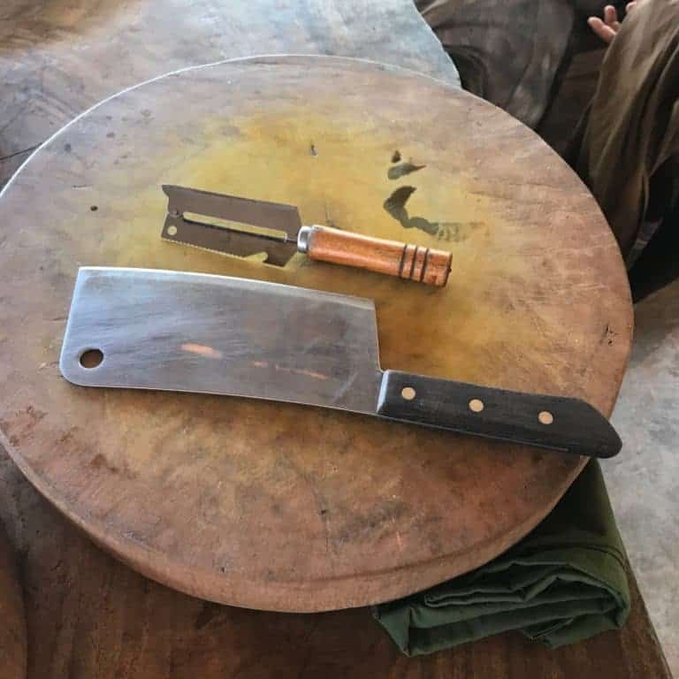 Khmer Cutting board with knife and grater placed on top