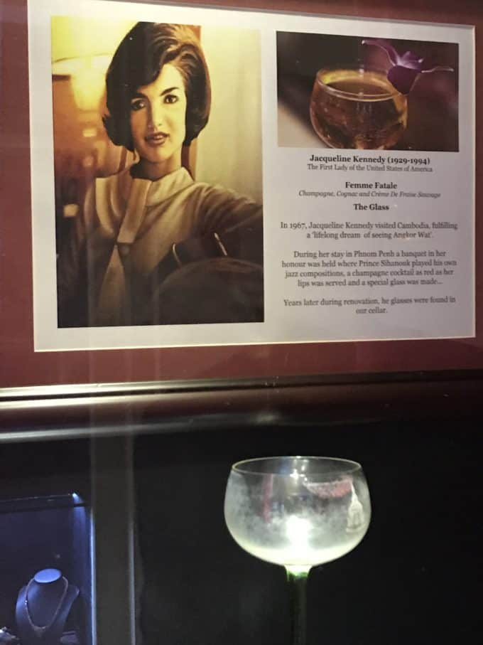 a display of a champagne glass with lipstick marks made from jacqueline Kennedy