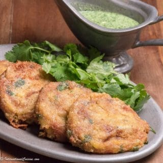 4 golden chicken patty kebabs alongside green chutney dipping sauce