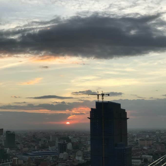 the sun setting over Phnom Penh