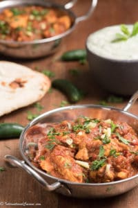 chicken Karahi with naan bread and chilies