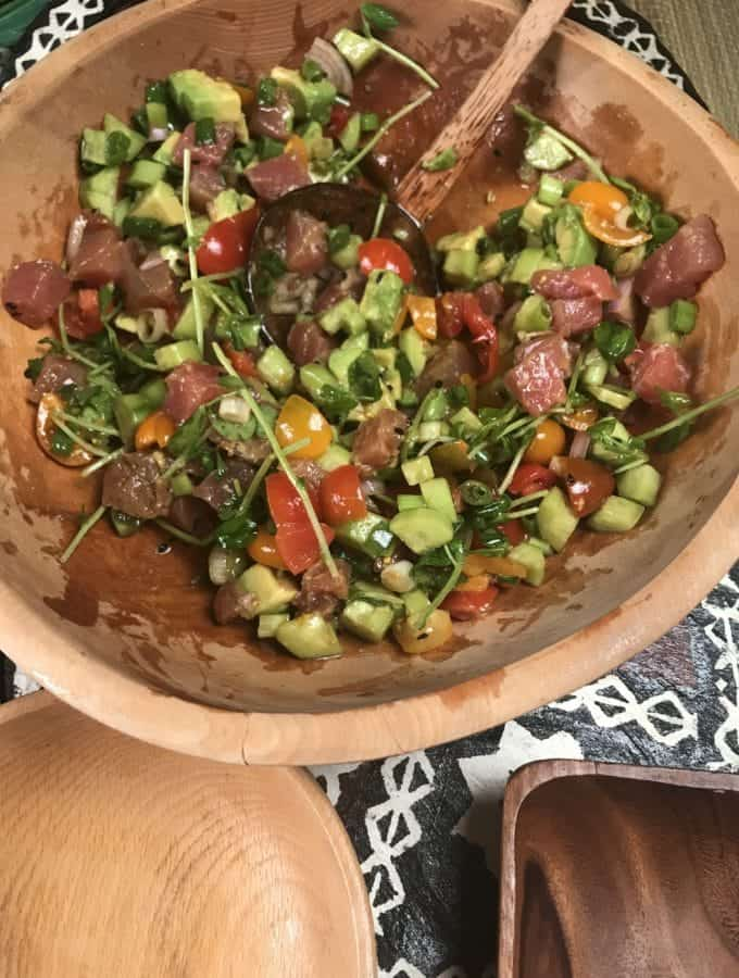 a bowlful of fresh chopped, tomatoes, shallots, cucumber, avocado and fresh ahi tuna, a colorful poke salad