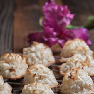 Panamanian Cocadas on a cooling rack with a purple orchid in the background