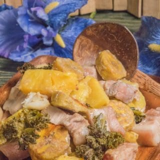 a dish called mumu filled with cooked sweet potato, plantains, taro root, chicken, pork belly, kale and pineapple.