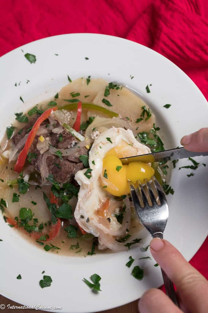A bowl of Paraguayan beef stew with beef, egg and broth
