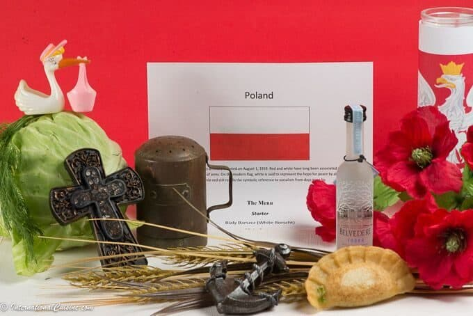 Symbols of Poland Flag, peirogi, vodka, anchor, salt shaker, corn poppies, cabbage, stork, dill and a cross.