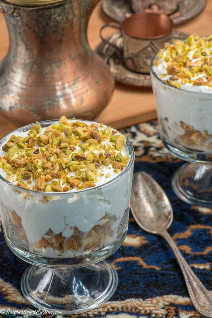 A sweet creamy dessert topped with pistachio nuts called esh asaraya