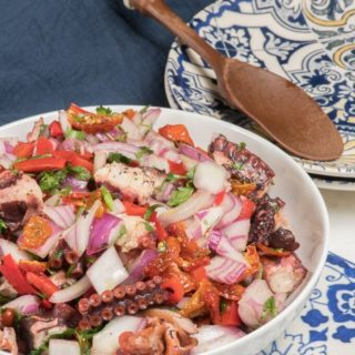 a bowl of portuguese octopus salad/