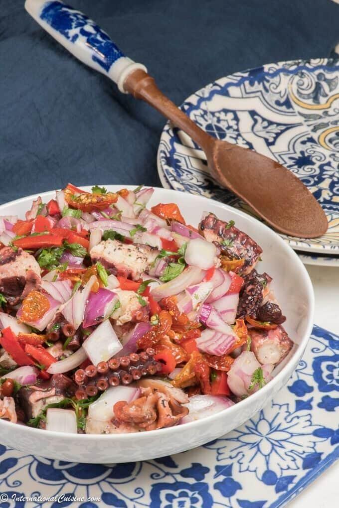 a bowl of portuguese octopus salad/