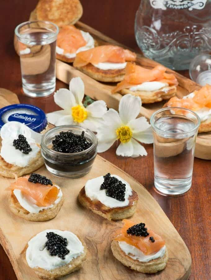 Russin Blinis topped with sour cream, caviar and salmon