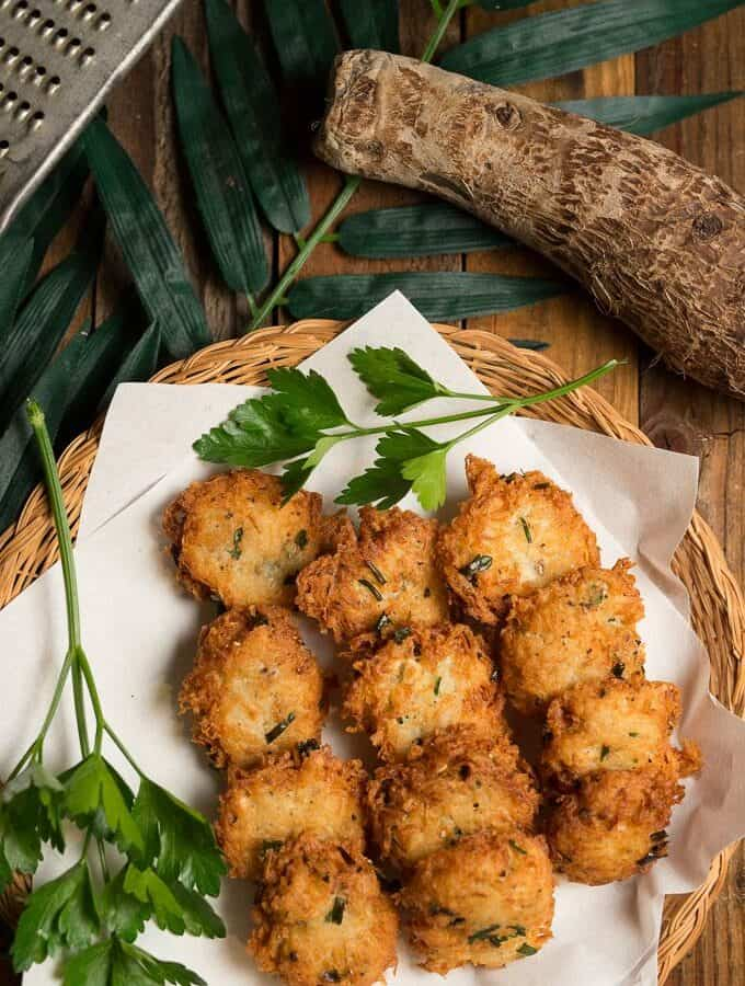A plate full of fried fritters made from Malanga