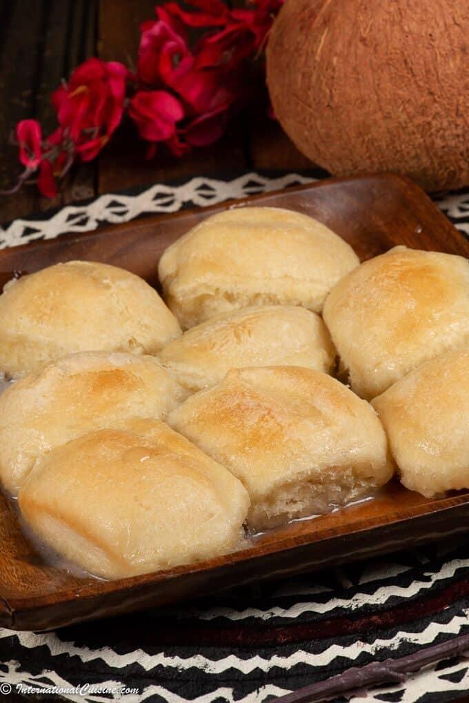 A plate full of Pani Popo Samoan coconut rolls