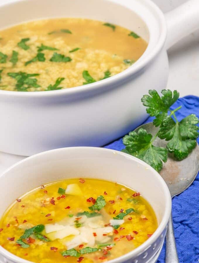 A tureen and bowl of Italian egg drop soup