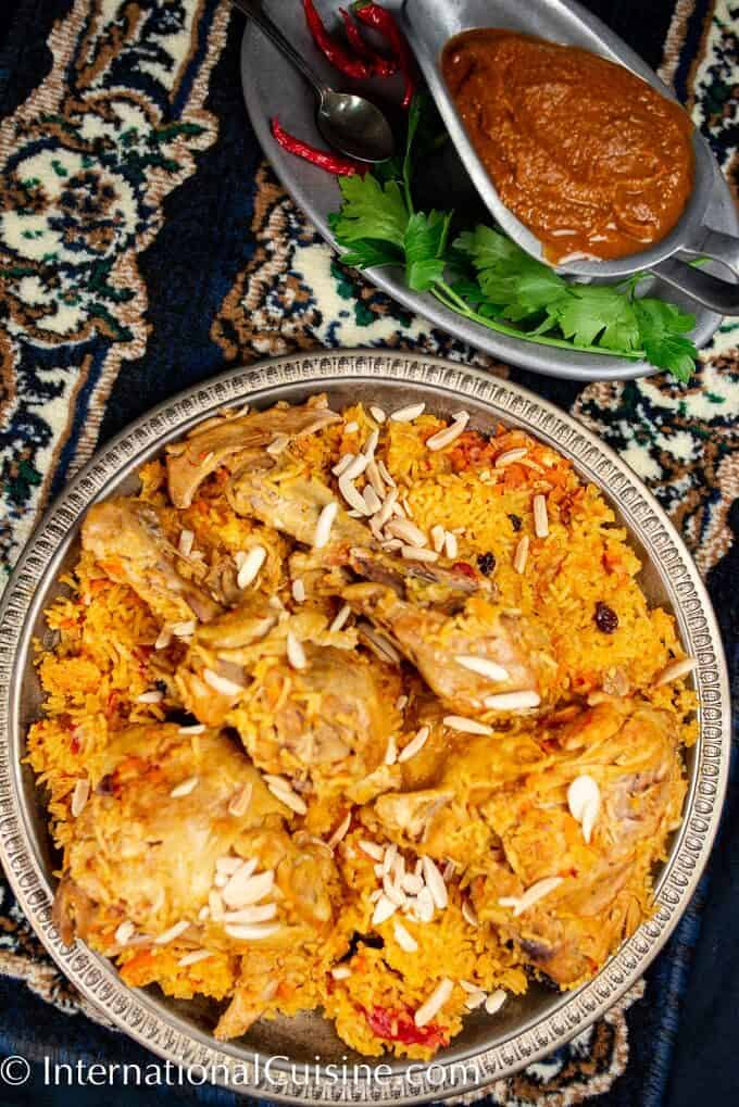 A platter filled with spiced rice and chicken a dish called Al Kabsa, the national dish of Saudi Arabia.
