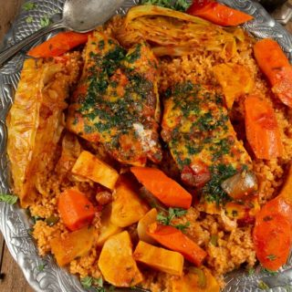 A platter of the national dish of Senegal called Thieboudienne.