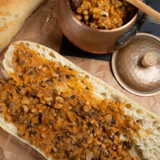 A french baguette smothed with a spicy bean dish called ndmabe in Senegal