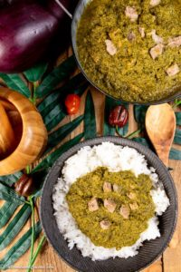 A platter of cassava leaf stew over rice.
