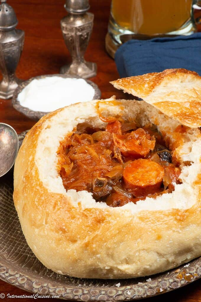 A bread bowl filled with hearty Slovak Sauerkraut Soup