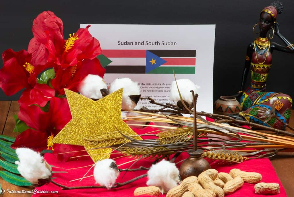 symbols of Sudan and South Sudan cotton, wheat, an oil can and some peanuts.