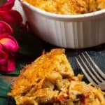 A slice of pom a chicken and root vegetable casserole