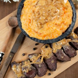 thin slices of ostrich steak with a cream sauce served with a pumpkin mash.