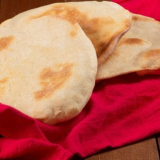Pieces of freshly made Syrian pita bread