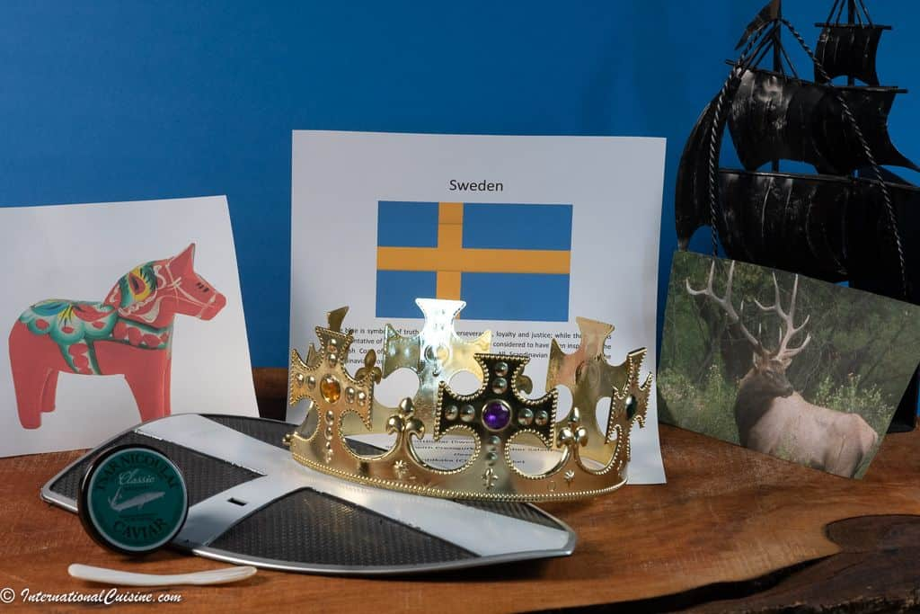 Symbols of Sweden, the flag, dala horse, crown, viking ship a shield, caviar and a picture of an elk.