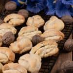a pan full of Tajikistan cookies garnished with walnuts.