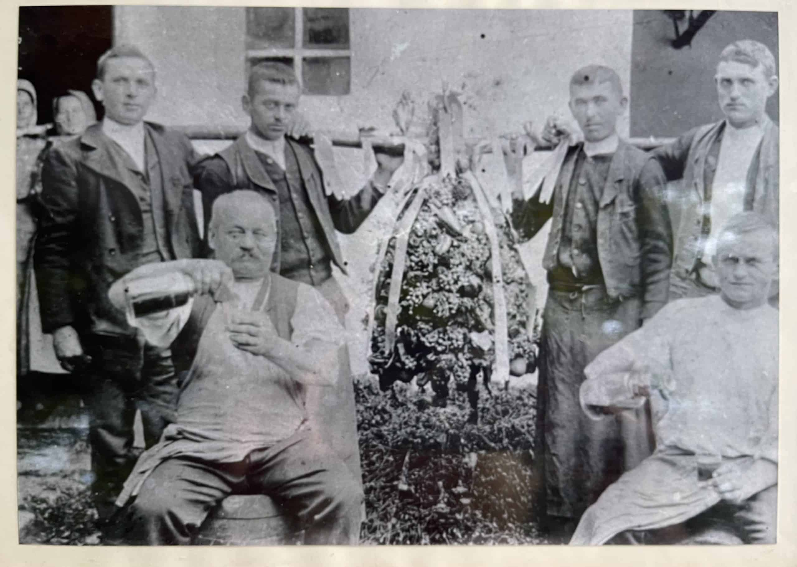 Great Grandfather and Grandfather Schieszl celebrating Harvest